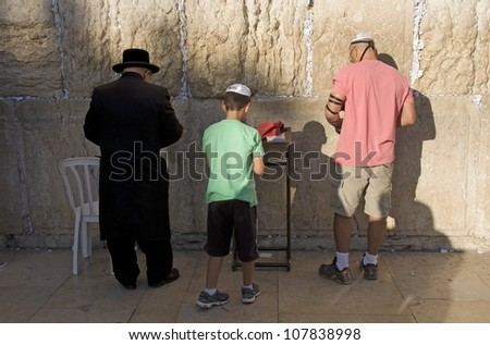 JERUSALEM - MAY 31 : Jewish man  prays in The western wall on May 31 2012, The Western wall is important Jewish religious site located in the Old City of Jerusalem , Israel - stock photo
