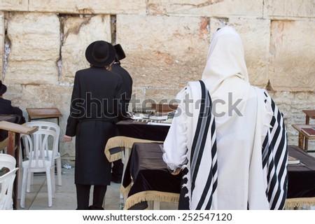 JERUSALEM -May 23 : Jews prays at the Western Wall May 23 , 2014 in Jerusalem, Israel.  - stock photo