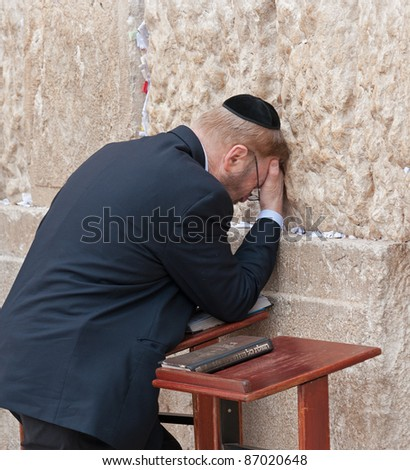JERUSALEM - MAY 10 : The wailing Wall main religious symbol of Israel. Jews pray at the wailing wall in the threshold of the holiday Lag ba-Omer on May 10, 2009 in Jerusalem. - stock photo