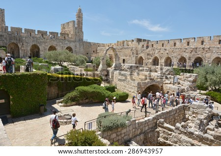 JERUSALEM - MAY 05 2015:Visitors at the Tower of David and archeological garden in Jerusalem, Israel.It's a famous landmark of Jerusalem with historical and archaeological significant.