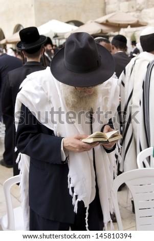 JERUSALEM-OCT 02: Orthodox  Jew  at the Western Wall during Jewish holiday of Sukkot, October 2, 2012 in Jerusalem, Israel. - stock photo