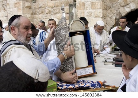 JERUSALEM-OCT 02: The Jews  at the Western Wall during Jewish holiday of Sukkot, October 2, 2012 in Jerusalem, Israel. - stock photo