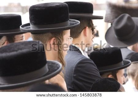 JERUSALEM-OCT 02: Unidentified orthodox  Jews  at the Western Wall during Jewish holiday of Sukkot, October 2, 2012 in Jerusalem, Israel. - stock photo