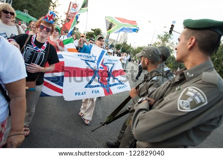 JERUSALEM - OCTOBER 4: Christian Zionists, a fundamentalist movement known for its uncritical support for Israel, offer blessings to Israeli soldiers during the annual Jerusalem March, Oct. 4, 2012. - stock photo