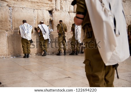 JERUSALEM - OCTOBER 21: Israeli soldiers pray at Jerusalem's Western Wall, Oct. 21, 2012. Israel's annexation of East Jerusalem in 1967, including the Old City, was never internationally recognized.
