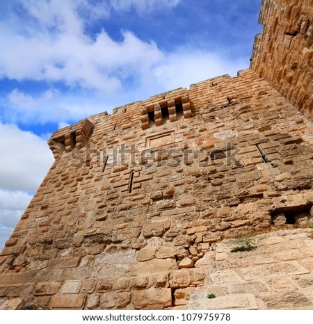Jerusalem Old city fortification stone wall against blue sky - Upward view - stock photo