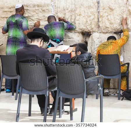 JERUSALEM OLD TOWN, ISRAEL - NOVEMBER 2, 2014:  Unidentified Jewish people pray next to Western Wall - stock photo