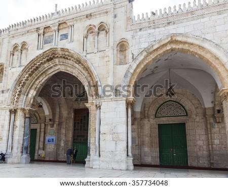 JERUSALEM OLD TOWN, ISRAEL - NOVEMBER 2, 2014:  Unidentified pilgrims and prayers near Al-Aqsa Mosque (al-Masjid al-Aqsa) on Temple Mount. - stock photo