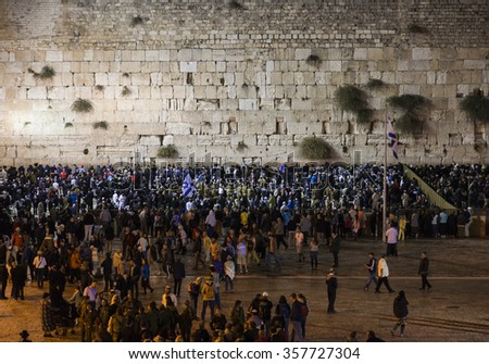 JERUSALEM OLD TOWN, ISRAEL - OCTOBER 31, 2014: Shabbat celebration at Kotel (Western Wall). It is usually much more people the on Friday night than any other time of the week. - stock photo