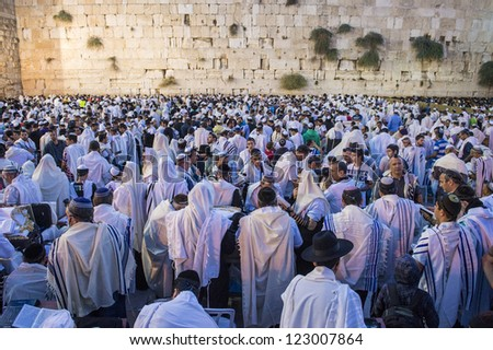 JERUSALEM - SEP 25 : Jewish men prays during the penitential prayers the Selichot , held on September 25 2012 in the Wailing wall in Jerusalem Israel - stock photo