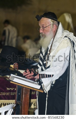 """JERUSALEM - SEP 26 : Jewish old man prays during the penitential prayers the """"Selichot"""" , held on September 26 2011 in the """"Wailing wall""""  in  Jerusalem , Israel - stock photo"""