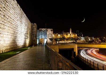 Jerusalem wall and Jaffa Gate at night - stock photo