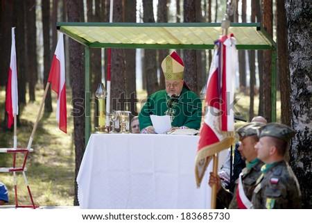 Jerzyska, Poland, Sept 18: Bishop Antoni Dydycz celebrate Mass at the outdoor anniversary mass- place where AK soldiers was shooten, september 18, 2013 in Jerzyska, Poland. - stock photo
