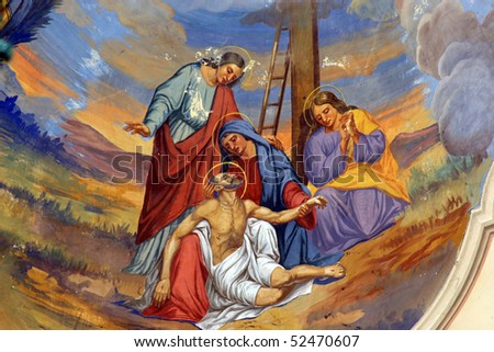 Jesus' body is removed from the cross - stock photo