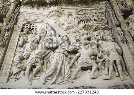 Jesus carved in stone inside church - stock photo