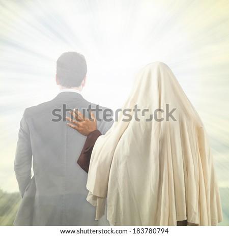 Jesus Christ accompanies the soul of a man towards the Kingdom of Heaven. - stock photo