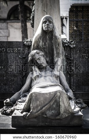 jesus christ and virgin mary statue in the cemetery - stock photo