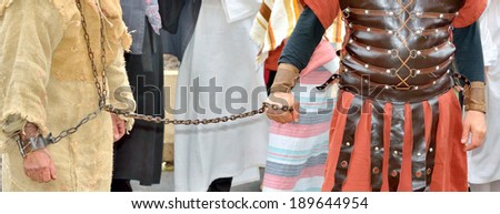 Jesus Christ chained to a Roman soldier - stock photo