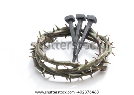 Jesus Christ crown of thorns and nails on a white background. Focus is on part of the nails. - stock photo