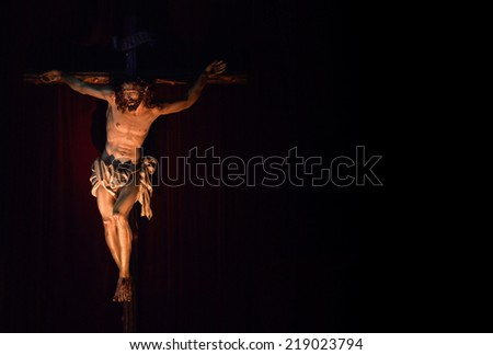 Jesus Christ crucified. Catholic symbol. Copy Space - stock photo