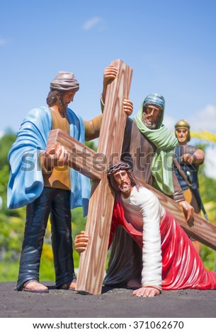 Jesus Christ Falls while Carrying His Cross - stock photo