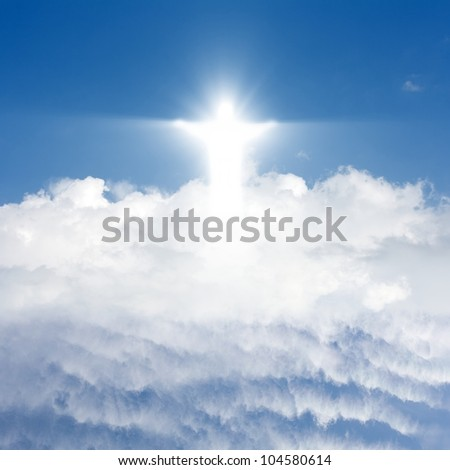 Jesus Christ in blue sky with white clouds - heaven - stock photo