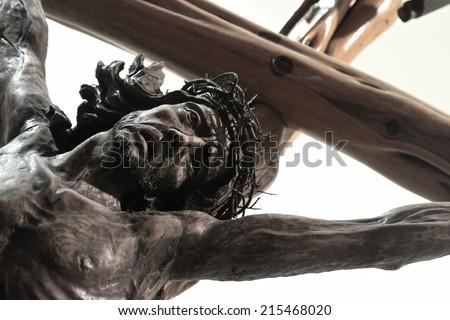 Jesus Christ in cross - wooden sculpture - stock photo