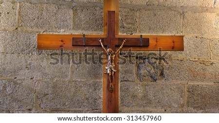 Jesus Christ in the shadows illuminated only with day light - stock photo