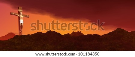 Jesus Christ on the cross among the rocky mountains by sunset