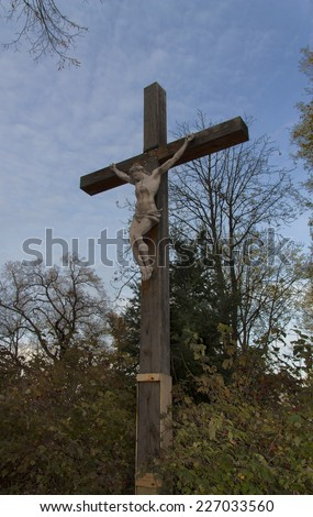 Jesus Christ on the Cross with Clouds photo - stock photo