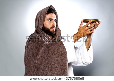 Jesus Christ praying to God consecration the bread and wine. - stock photo