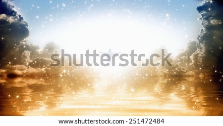 Jesus Christ silhouette in shining skies over sea, bright light from heaven - stock photo