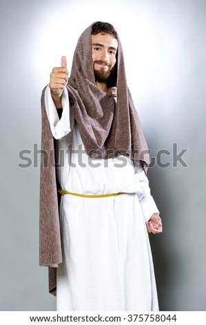 Jesus Christ Son of God smiling signal ok - stock photo