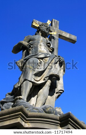Jesus Christ with the Cross-statue on the Charles Bridge in Prague, Czech Republic (portrait orientation).