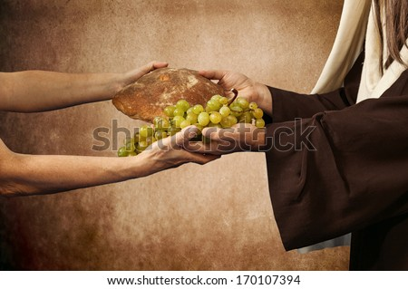 Jesus gives bread and grapes on beige background - stock photo