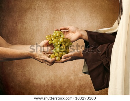 Jesus gives grapes to a beggar on beige background. - stock photo