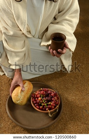 Jesus hands holding communion symbols: bread and wine - stock photo