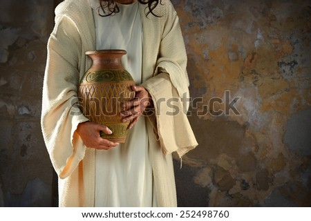 Jesus hands holding water jar ready to wash the disciples' feet - stock photo
