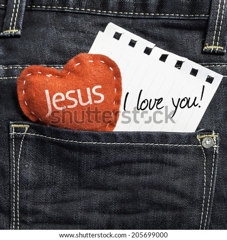 Jesus I love you! written on a peace of paper and a heart on a jeans background - stock photo