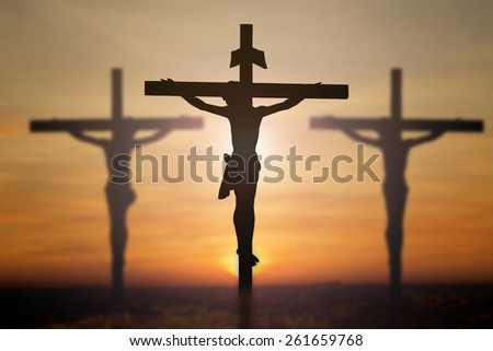 Jesus on cross with blur beautiful background. - stock photo