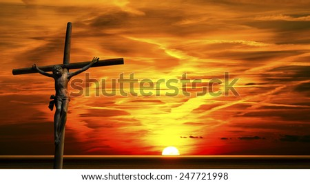 Jesus on the Cross at Sunset. The cross (bronze and wood) - Jesus on the Cross at beautiful sunset over the sea with cloudy sky