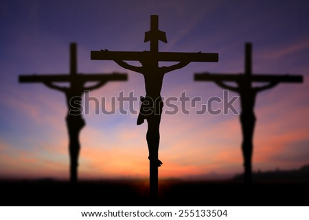 Jesus on the cross in sun rise blur background - stock photo