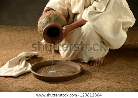 Jesus pouring water from a jar a metaphor - stock photo