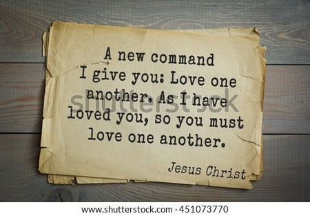 Jesus quote on old paper background. A new command I give you: Love one another. As I have loved you, so you must love one another. - stock photo