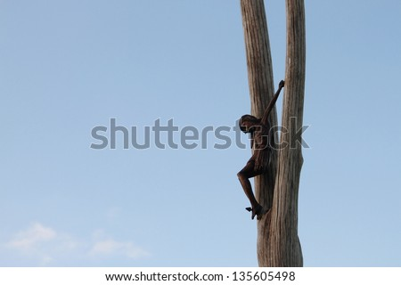 Jesus sculpture nailed to tree brisbane australia - stock photo