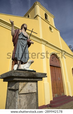 jesus statue in front of christian church in San Juan del Sur in Nicaragua - stock photo