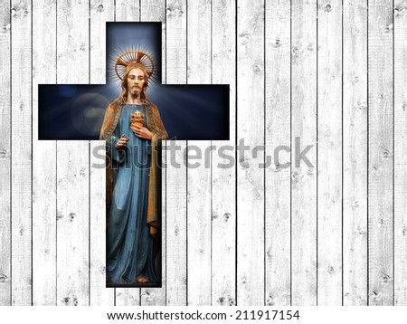 Jesus with cross  and wood background - stock photo