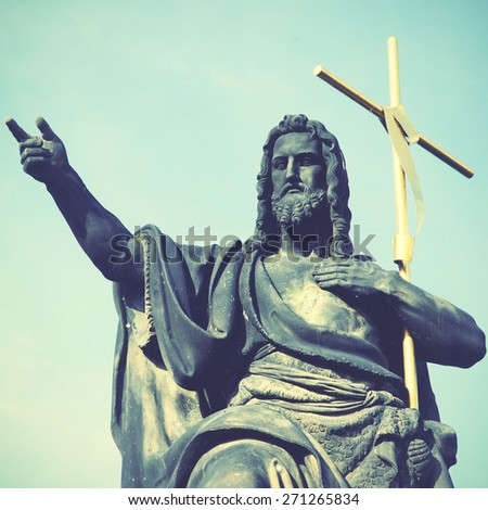 Jesus with cross at Charles bridge in Prague. Instagram style filtred image - stock photo