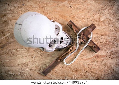 Jesus with the cross and skull on wooden background,Faith belief and hope concept - stock photo