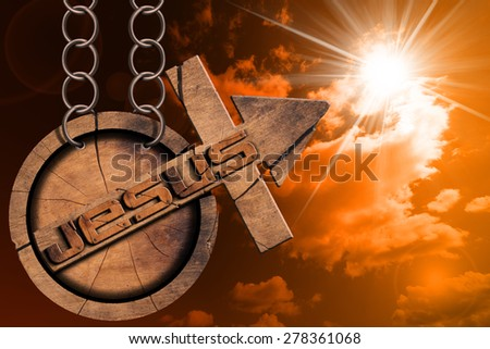 Jesus Wooden Symbol with Cross at the Sunset. Wooden symbol with cross and arrow upward and text Jesus. Hanging from a chain at sunset  with cloudy sky and sun rays - stock photo